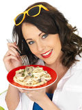 Beautiful Happy Young Woman Holding a Plate of Spaghetti Carbonara Cream Pasta Royalty Free Stock Photos