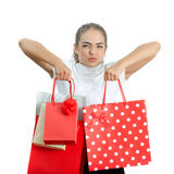 Beautiful Happy Young Woman Holding Shopping Bags. Beautiful Happy Young Woman Holding Red Shopping Bags Royalty Free Stock Photography