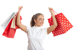 Beautiful Happy Young Woman Holding Shopping Bags. Red and White Colors Royalty Free Stock Images