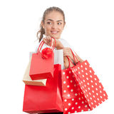 Beautiful Happy Young Woman Holding Shopping. Bags. Red and White Colors Stock Image
