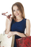Beautiful happy young woman  holding shopping gift bags. Stock Photography