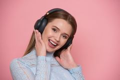 Beautiful happy young woman listen music and using mobile application isolated on white. stock photo