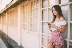 Beautiful happy young woman on the mobile phone.  Royalty Free Stock Photos