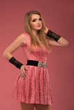 Beautiful happy young woman in pink dress on pink background royalty free stock photos