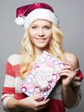 Beautiful happy young woman in Santa Claus hat royalty free stock photo