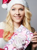 Beautiful happy young woman in Santa Claus hat stock photos