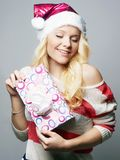 Beautiful happy young woman in Santa Claus hat royalty free stock photos