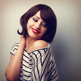 Beautiful happy young woman with short hair looking down. Vintag Stock Photography