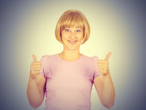 Beautiful happy young woman showing Ok, thumbs up sign isolated Stock Image