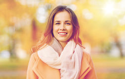 Beautiful happy young woman smiling in autumn park Royalty Free Stock Photo