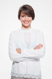 Beautiful happy young woman standing with crossed arms Royalty Free Stock Images