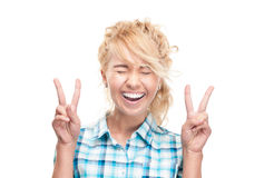 Beautiful happy young woman victory gesture. Royalty Free Stock Photos