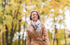 Beautiful happy young woman walking in autumn park Stock Images
