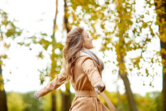 Beautiful happy young woman walking in autumn park Stock Photography