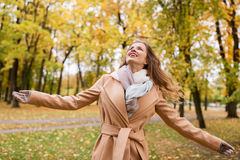 Beautiful happy young woman walking in autumn park Royalty Free Stock Images