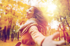 Beautiful happy young woman walking in autumn park Royalty Free Stock Photos