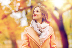 Beautiful happy young woman walking in autumn park Stock Image
