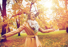 Beautiful happy young woman walking in autumn park Royalty Free Stock Photography