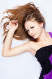 Beautiful harmonous young woman with long hair. Lying on a back Royalty Free Stock Image