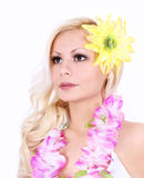 Beautiful Hawaiian girl with yellow flower on hair Stock Photo