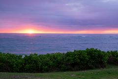 Beautiful Hawaiin Beach at Sunrise. Sunrise over Bathtub Beach in the small town of Laie on Oahu Hawaii. Beautiful colors at dawn Stock Image