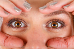 Beautiful hazel eyes. Close up picture of a young woman`s hazel eyes stock image