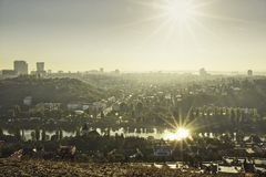Beautiful HDR landscape panorama of Prague with sun reflected in Vltava river taken from Zvahov hill.  royalty free stock image