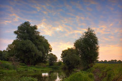 Beautiful HDR view of river Zagyva at dusk. View of river Zagyva at dusk hdr image Royalty Free Stock Photo