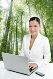 Beautiful headset woman in an forest Royalty Free Stock Photography
