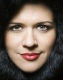 Beautiful headshot in black fur. Headshot of a beautiful woman wrapped in a black fur Royalty Free Stock Image