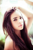 Beautiful headshot of latina model looking into Royalty Free Stock Image