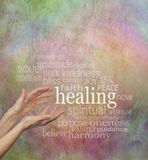 Beautiful Healing Words. Pair of female hands reaching up to the word healing, surrounded by a word cloud of healing related words on a rustic stone effect Royalty Free Stock Images