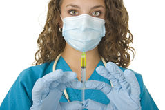 Beautiful health Care Professional prepares needle Royalty Free Stock Image