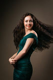 Beautiful healthful curved girl waved her curly Royalty Free Stock Photo