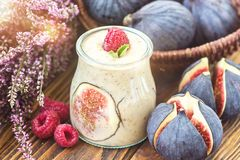 Beautiful healthy appetizer figs fruit smoothie milk shake in glass jar decorated fresh figs pink raspberries  top view. Natural d. Etox Liquid ice cream. Yogurt Royalty Free Stock Images