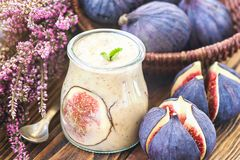 Beautiful healthy appetizer figs fruit smoothie or milk shake in glass jar with fresh figs, top view. Natural detox. Liquid ice cr. Eam. Yogurt cocktail dessert stock photo