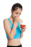 Beautiful healthy Asian girl hate  tomato juice Royalty Free Stock Image