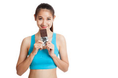 Beautiful healthy Asian girl love chocolate Royalty Free Stock Photos
