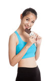Beautiful healthy Asian girl love chocolate Royalty Free Stock Image