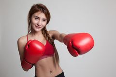 Beautiful healthy Asian girl with red boxing glove. Royalty Free Stock Images