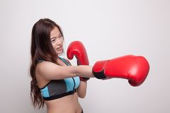 Beautiful healthy Asian girl with red boxing glove. Beautiful healthy Asian girl with red boxing glove on white background Royalty Free Stock Photography