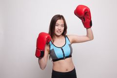 Beautiful healthy Asian girl with red boxing glove. Beautiful healthy Asian girl with red boxing glove on white background Royalty Free Stock Images