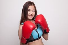 Beautiful healthy Asian girl with red boxing glove. Beautiful healthy Asian girl with red boxing glove on white background Stock Image