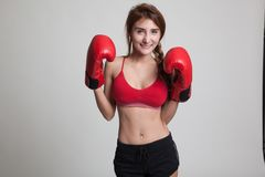 Beautiful healthy Asian girl with red boxing glove. Royalty Free Stock Photography