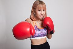 Beautiful healthy Asian girl with red boxing glove. Royalty Free Stock Photo