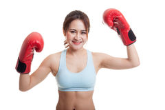 Beautiful healthy Asian girl with red boxing glove. Beautiful healthy Asian girl with red boxing glove  isolated on white background Stock Image