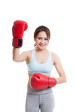 Beautiful healthy Asian girl with red boxing glove. Beautiful healthy Asian girl with red boxing glove  isolated on white background Royalty Free Stock Photos