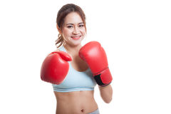 Beautiful healthy Asian girl with red boxing glove. Beautiful healthy Asian girl with red boxing glove  isolated on white background Stock Photo
