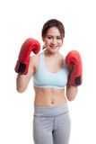 Beautiful healthy Asian girl with red boxing glove. Beautiful healthy Asian girl with red boxing glove  isolated on white background Royalty Free Stock Image