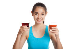 Beautiful healthy Asian girl with tomato juice and cola drinks Royalty Free Stock Images